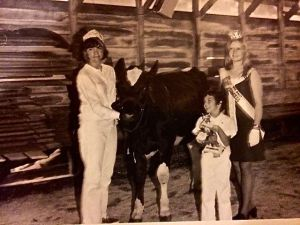 Tum-A-Lum Model Shelly, 1968, with my sister Patty at the halter, me with the trophy, and Pam Hawksley, RI Dairy Princess (and my future 4-H leader).